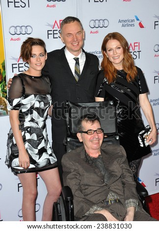 "LOS ANGELES, CA - NOVEMBER 12, 2014: Kristen Stewart & Julianne Moore with directors Wash Westmoreland & Richard Glatzer at the premiere of ""Still Alice"" at the Dolby Theatre.   - stock photo"