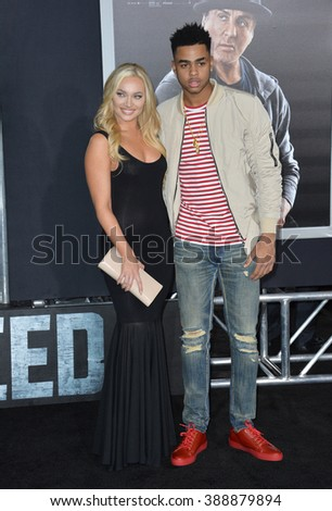 """LOS ANGELES, CA - NOVEMBER 19, 2015: LA Lakers basketball star D'Angelo Russell & guest at the Los Angeles World premiere of """"Creed"""" at the Regency Village Theatre, Westwood. - stock photo"""