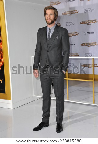 """LOS ANGELES, CA - NOVEMBER 17, 2014: Liam Hemsworth at the Los Angeles premiere of his movie """"The Hunger Games: Mockingjay Part One"""" at the Nokia Theatre LA Live.  - stock photo"""