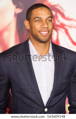 LOS ANGELES, CA - NOVEMBER 18: Los Angeles Laker Xavier Henry arrives at the premiere of The Hunger Games: Catching Fire at the Nokia Theater in Los Angeles, CA on November 18, 2013 - stock photo