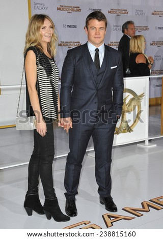 """LOS ANGELES, CA - NOVEMBER 17, 2014: Luke Hemsworth & wife Samantha at the Los Angeles premiere of """"The Hunger Games: Mockingjay Part One"""" at the Nokia Theatre LA Live.  - stock photo"""
