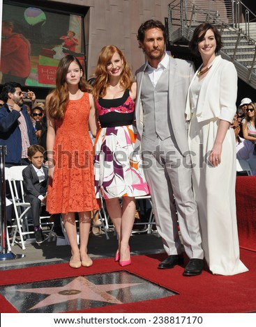 LOS ANGELES, CA - NOVEMBER 17, 2014: Matthew McConaughey & Interstellar co-stars Mackenzie Foy, Jessica Chastain & Anne Hathaway on Hollywood Blvd where he received a star on the Walk of Fame.  - stock photo