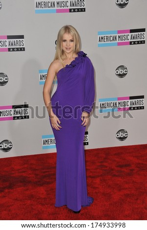 LOS ANGELES, CA - NOVEMBER 20, 2011: Mika Newton arriving at the 2011 American Music Awards at the Nokia Theatre, L.A. Live in downtown Los Angeles.  - stock photo