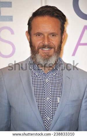 LOS ANGELES, CA - NOVEMBER 4, 2014: Producer Mark Burnett at the nominations announcement for the 2015 People's Choice Awards at the Paley Center for Media, Beverly Hils.  - stock photo