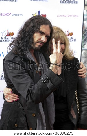 LOS ANGELES, CA - NOVEMBER 06: Russell Brand and his mother arrive at A Day Of Champions Benefiting the Bogart Pediatric Cancer Research Program at Sports Museum of Los Angeles on November 6, 2011. - stock photo