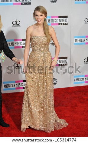 LOS ANGELES, CA - NOVEMBER 20, 2011: Taylor Swift arriving at the 2011 American Music Awards at the Nokia Theatre, L.A. Live in downtown Los Angeles. November 20, 2011  Los Angeles, CA - stock photo