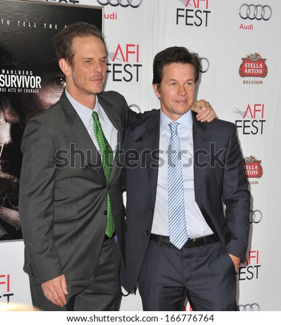 """LOS ANGELES, CA - NOVEMBER 12, 2013: Writer/director Peter Berg (left) & Mark Wahlberg at the premiere of """"Lone Survivor"""", part of the AFI Fest 2013, at the TCL Chinese Theatre, Hollywood.  - stock photo"""