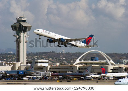LOS ANGELES, CA - OCTOBER 23: A Delta Airlines passenger jet takes off from Los Angeles International Airport in Los Angeles, CA on October 23, 2012. Delta flies 160 million passengers to 59 nations. - stock photo