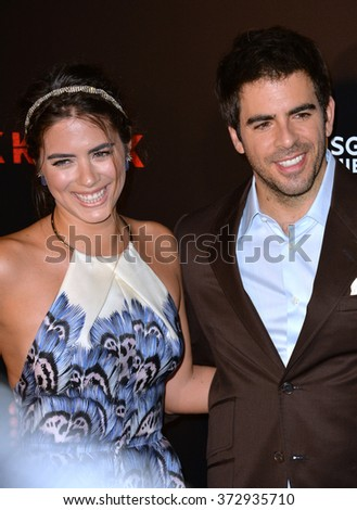"LOS ANGELES, CA - OCTOBER 7, 2015: Actress Lorenza Izzo & director Eli Roth at the Los Angeles premiere of their movie ""Knock Knock"" at the TCL Chinese Theatre, Hollywood.