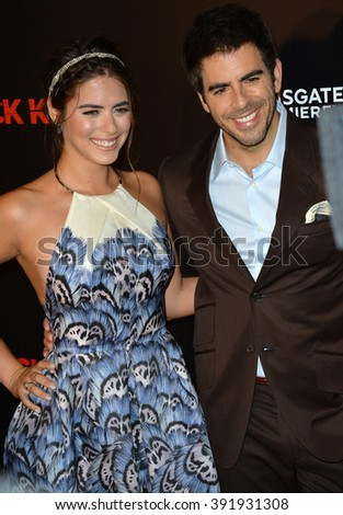 "LOS ANGELES, CA - OCTOBER 7, 2015: Actress Lorenza Izzo & director Eli Roth at the Los Angeles premiere of their movie ""Knock Knock"" at the TCL Chinese Theatre, Hollywood."