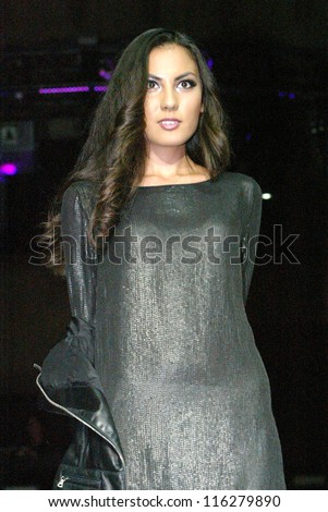 LOS ANGELES, CA - OCTOBER 18:  An unidentified model walks the runway during the 2012 Fashion Minga fashion show during LA Fashion Week at Exchange LA on October 18, 2012 in Los Angeles, CA - stock photo