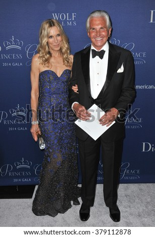LOS ANGELES, CA - OCTOBER 8, 2014: George Hamilton & Alana Stewart at the 2014 Princess Grace Awards Gala at the Beverly Wilshire Hotel, Beverly Hills.