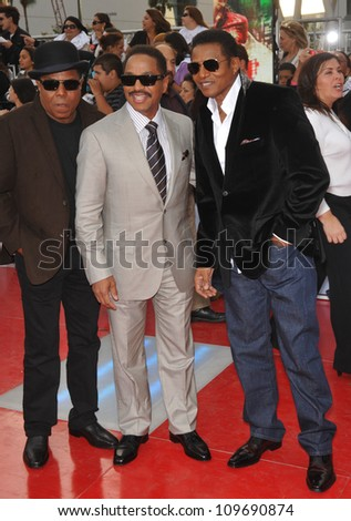 "LOS ANGELES, CA - OCTOBER 27, 2009: Jackie Jackson, Tito Jackson & Marlon Jackson at the premiere of Michael Jackson's ""This Is It"" at the Nokia Theatre, L.A. Live. - stock photo"