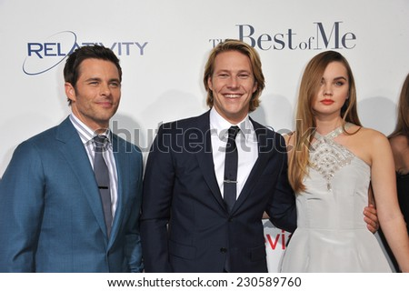 """LOS ANGELES, CA - OCTOBER 7, 2014: James Marsden (left) & Liana Liberato & Luke Bracey at the world premiere of their movie """"The Best of Me"""" at the Regal Cinemas LA Live.  - stock photo"""