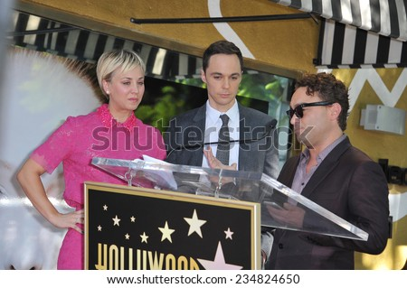 LOS ANGELES, CA - OCTOBER 29, 2014:  Kaley Cuoco & co-stars from The Big Bang Theory - Jim Parsons & Johnny Galecki - on Hollywood Blvd where she received star on the Hollywood Walk of Fame.  - stock photo