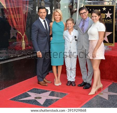 LOS ANGELES, CA - OCTOBER 12, 2015: Kelly Ripa & actor husband Mark Consuelos & children Joaquin, 12, Michael 18, & Lola, 14, on Hollywood Boulevard Walk of Fame. - stock photo