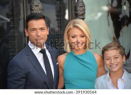 LOS ANGELES, CA - OCTOBER 12, 2015: Kelly Ripa & actor husband Mark Consuelos & son Joaquin Consuelos on Hollywood Boulevard where she was honored with the 2,561st star on the Hollywood Walk of Fame. - stock photo