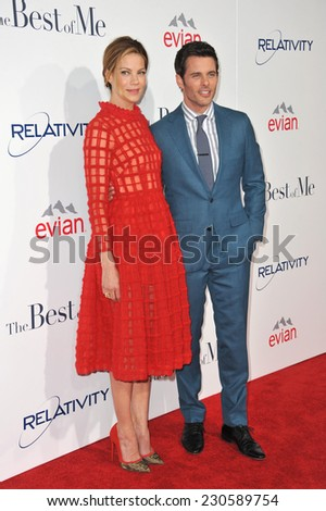 """LOS ANGELES, CA - OCTOBER 7, 2014: Michelle Monaghan & James Marsden at the world premiere of their movie """"The Best of Me"""" at the Regal Cinemas LA Live.  - stock photo"""