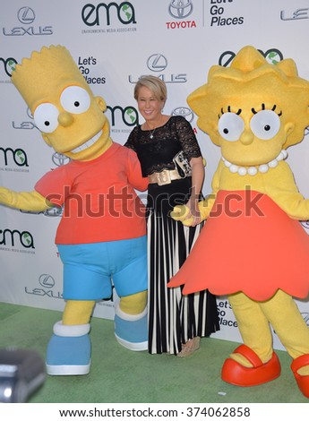LOS ANGELES, CA - OCTOBER 24, 2015: Simpson's voice actress Yeardley Smith & Bart Simpson & Lisa Simpson characters at the 25th Annual Environmental Media Awards at Warner Bros. Studios, Burbank  - stock photo