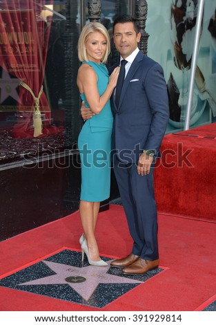 LOS ANGELES, CA - OCTOBER 12, 2015: TV personality Kelly Ripa & actor husband Mark Consuelos on Hollywood Boulevard where she was honored with the 2,561st star on the Hollywood Walk of Fame. - stock photo