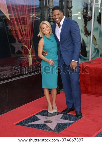LOS ANGELES, CA - OCTOBER 12, 2015: TV personality Kelly Ripa with Michael Strahan on Hollywood Boulevard where she was honored with the 2,561st star on the Hollywood Walk of Fame.