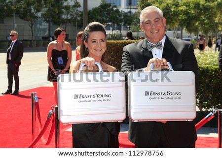 LOS ANGELES, CA - SEP 15: Ernst & Young reps with winners at the Academy Of Television Arts & Sciences 2012 Creative Arts Emmy Awards at Nokia Theater on September 15, 2012 in Los Angeles, CA