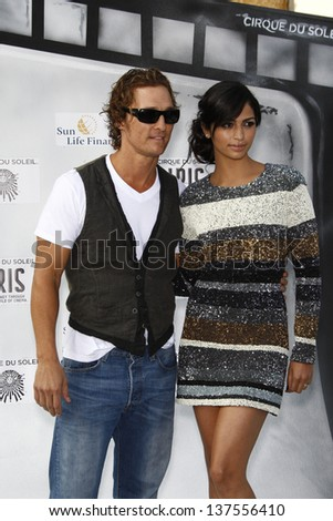 LOS ANGELES, CA - SEP 25: Matthew McConaughey; Camila Alves  at the IRIS, A Journey Through the World of Cinema by Cirque du Soleil premiere September 25, 2011 at Kodak Theater in Los Angeles, CA - stock photo