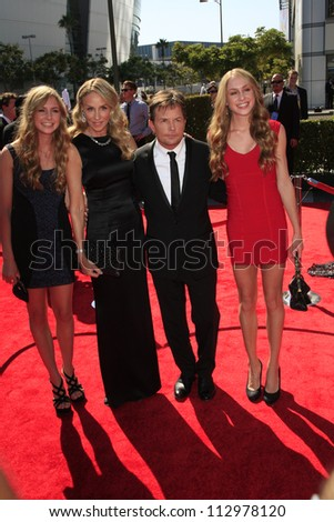 LOS ANGELES, CA - SEP 15: Michael J Fox, Tracy Pollan, daughters at the Academy Of Television Arts & Sciences 2012 Creative Arts Emmy Awards at Nokia Theater on September 15, 2012 in Los Angeles, CA