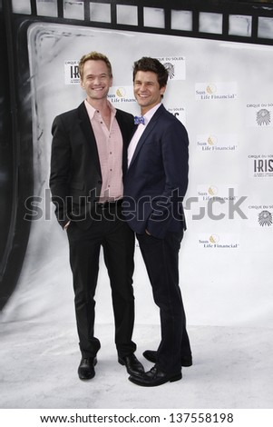 LOS ANGELES, CA - SEP 25: Neil Patrick Harris; David Burtka at the IRIS, A Journey Through the World of Cinema by Cirque du Soleil premiere September 25, 2011 at Kodak Theater in Los Angeles, CA - stock photo