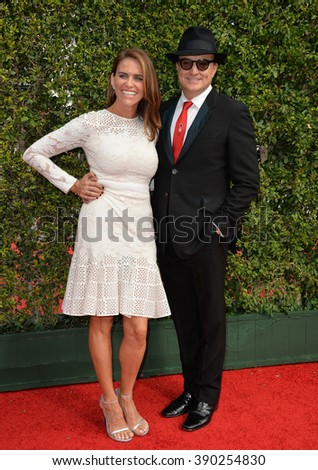 LOS ANGELES, CA - SEPTEMBER 12, 2015: Actors Bradley Whitford & Kim Dickens at the Creative Arts Emmy Awards 2015 at the Microsoft Theatre LA Live. - stock photo