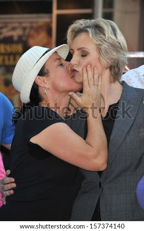 LOS ANGELES, CA - SEPTEMBER 4, 2013: Glee star Jane Lynch & friend on Hollywood Blvd where she was honored with the 2,505th star on the Hollywood Walk of Fame.  - stock photo
