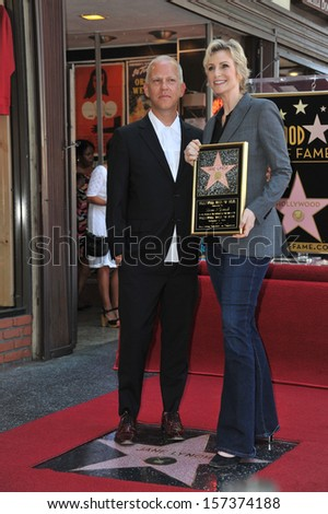 LOS ANGELES, CA - SEPTEMBER 4, 2013: Glee star Jane Lynch & producer Ryan Murphy on Hollywood Blvd where she was honored with the 2,505th star on the Hollywood Walk of Fame.  - stock photo