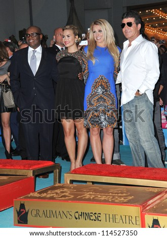 """LOS ANGELES, CA - SEPTEMBER 11, 2012: L.A. Reid (left), Demi Lovato, Britney Spears & Simon Cowell at the season two premiere of """"X Factor USA"""". - stock photo"""