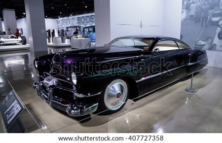 Los Angeles, CA, USA April 16, 2016: Purple 1948 Cadillac Sedanette reproduction called CadZZilla from the collection of rock band ZZ Top guitarist Billy Gibbons at the Petersen Automotive Museum
