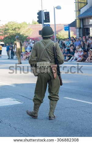 Los Angeles, CA - USA - August 16, 2015:  participating in military uniform of World War II during 75th Annual Nisei Week Grand Parade in Little Tokyo.