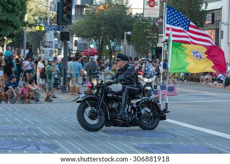 Los Angeles, CA - USA - August 16, 2015:  Police officers on motorcycles performing during 75th Annual Nisei Week Grand Parade in Little Tokyo. - stock photo
