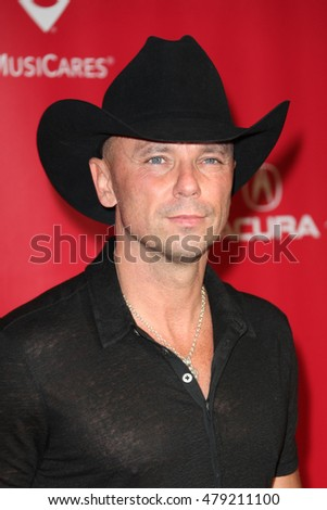 Los Angeles, CA, USA; February 2, 2013; Kenny Chesney arrives to the MusiCares 2013 Person Of The Year Tribute in Los Angeles, California.