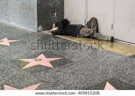 Los Angeles, CA, USA . January 16, 2016: Hollywood Walk of Fame homeless man on the street, sidewalk - stock photo