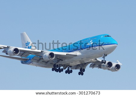 LOS ANGELES, CA/USA - JULY 24 2015: Photo of a Royal Dutch Airlines (KLM) aircraft, Boeing 747, shown approaching the Los Angeles World Airport (LAX).