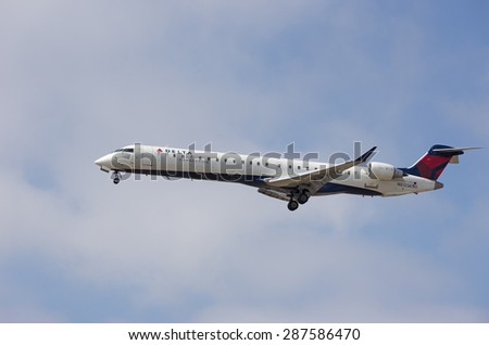 LOS ANGELES, CA/USA - JUNE 15 2015: Delta Connection aircraft (Bombardier CRJ-900, reg N813SK) shown shortly before landing at the Los Angeles World Airport (LAX).