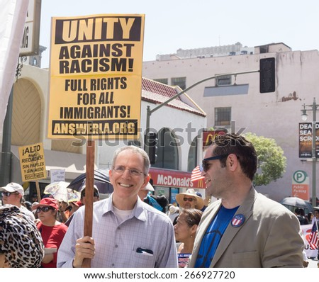 LOS ANGELES, CA/USA - MARCH 28, 2015:  Unidentified participants in an immigration reform rally in the United States. - stock photo