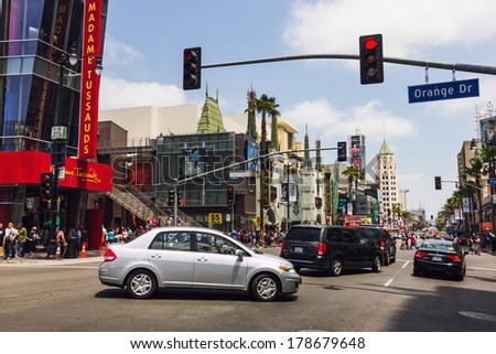 Los Angeles, CA, USA - MAY 27 2013:  Cars passing through street intersection in front of Madame Tussauds Wax Figure Museum in Hollywood - stock photo