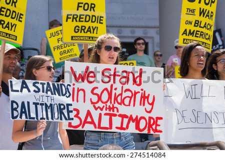Los Angeles, CA, USA - May 02, 2015: Group of people holding signs during march against the death of Freddie Gray, a man of Baltimore who was seriously injured in police custody. - stock photo