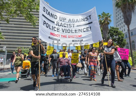 Los Angeles, CA, USA - May 02, 2015: Group with banners and posters during march against the death of Freddie Gray, a man of Baltimore who was seriously injured in police custody. - stock photo