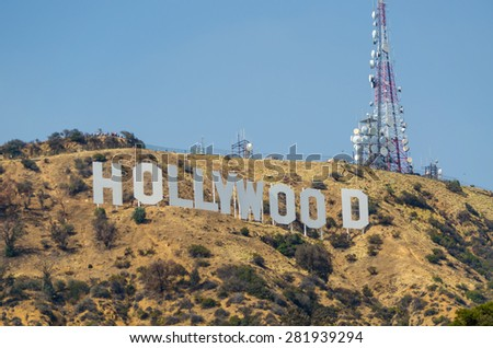 LOS ANGELES, CA/USA - MAY 25: Hollywood sign on May 25, 2015 in Los Angeles, CA, USA. It is a cultural icon located in the Hollywood hills area of the Santa Monica Mountains, and it was built in 1923. - stock photo