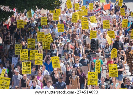 Los Angeles, CA, USA - May 02, 2015: Protestants in the streets with signs during march against the death of Freddie Gray, a man of Baltimore who was seriously injured in police custody. - stock photo