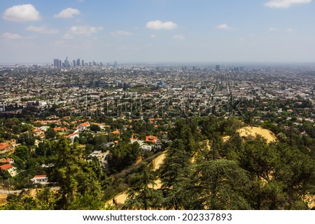 Los Angeles, CA, USA - 26th May 2013: Green residential area close to Los Angeles hills in a sunny day