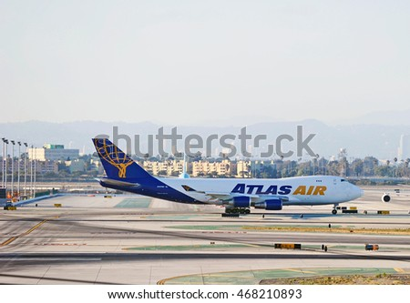 LOS ANGELES/CALIFORNIA - AUG. 12, 2016: Atlas Air Boeing 747 cargo aircraft taxiing along the runway at Los Angeles International Airport, Los Angeles, California USA