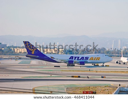 LOS ANGELES/CALIFORNIA - AUG. 12, 2016: Atlas Air Boeing 747 commercial cargo aircraft taxiing along runway at Los Angeles International Airport, Los Angeles, California USA