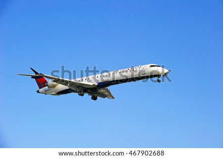 LOS ANGELES/CALIFORNIA - AUG. 5, 2016: Delta Connection Bombardier CL-600-2D24 commercial aircraft approaching runway for a landing at Los Angeles International Airport, Los Angeles, California USA